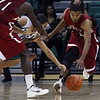 RCatEMU-3.11232011<br /> Ian Jenkens (right), Rochester College, takes the ball away from Antoine Chandler, Eastern Michigan University, during mens varsity basketball action at Eastern Michigan University Wednesday, Nov. 23, 2011. (Rochester College Photo / Larry McKee)