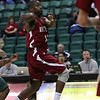 RCatEMU-1.11232011<br /> Rochester College guard Stephan Henning dishes off to a teammate during mens varsity basketball action at Eastern Michigan University Wednesday, Nov. 23, 2011. (Rochester College Photo / Larry McKee)