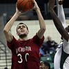 RCatEMU-2.11232011<br /> Rochester College center Ricky Doran (30) goes up for a shot during mens varsity basketball action at Eastern Michigan University Wednesday, Nov. 23, 2011. (Rochester College Photo / Larry McKee)