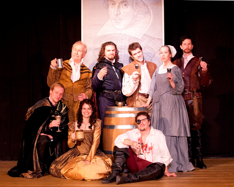 The cast of the West End Players Guild production of Murdering Marlowe, directed by Bob Mitchell:    Front row, L to R: Reynard Fox as Henry Maunder; Maggie Murphy as Emilia Lanier; John Wolbers as Christopher Marlowe.  Back row, L to R:  Jim Hurley as Philip Henslow; Michael Perkins as William Shakespeare; Todd Moore as Ingram Frizer; Laura Singleton as Anne Hathaway; David Wassilak as Robert Poley.