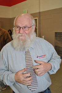 "Board Member Harvey plays his 'washboard"" metal tie. Really."