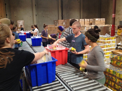Working at the LA food bank. Preparing food to be sent out on food trucks to communities.