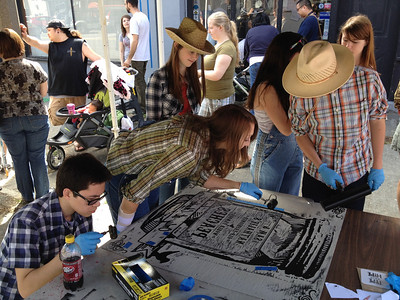 Upper School Art Students ink their steamroller print for Tacoma's 8th annual Wayzgoose.