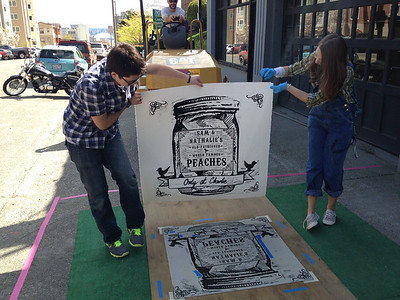 Upper School Art Students display their finished steamroller print from Wayzgoose 2012.