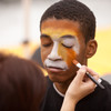 Student having face painted during 2011 Homecoming tailgate party.