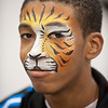 Student with Bengal tiger face paint during 2011 Homecoming tailgate party.
