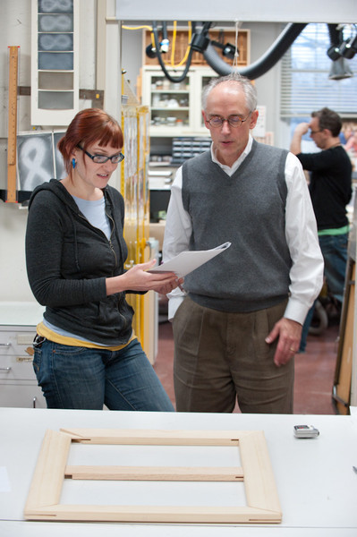 Students working with professor James Hamm in Art Conservation paintings lab.