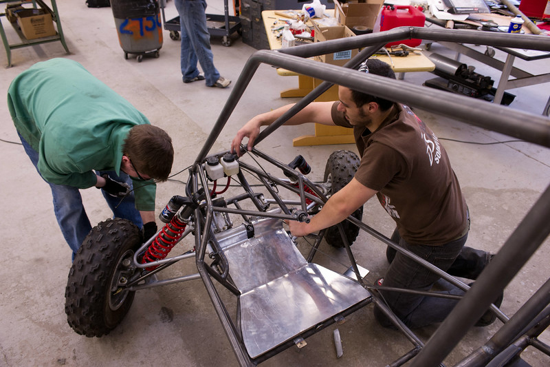 Technology students at SUNY Buffalo State working on mini baja car.