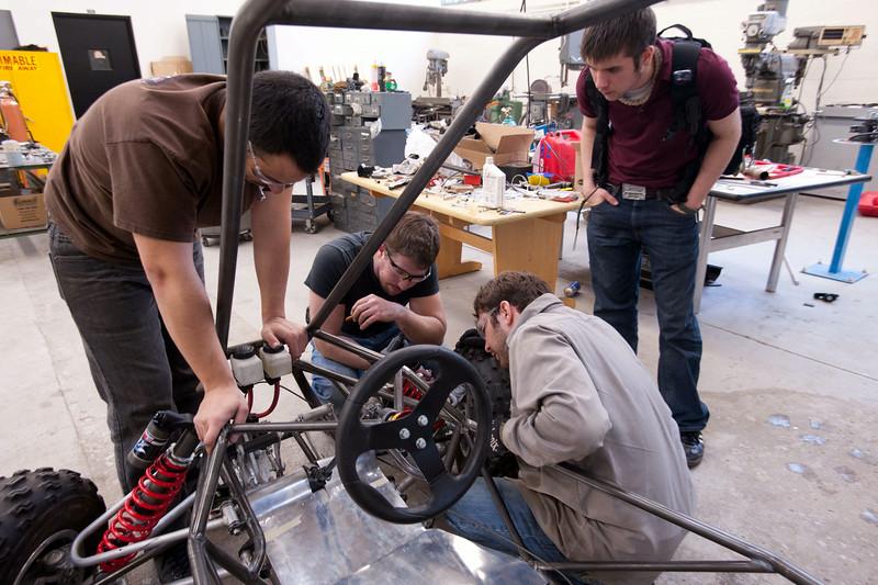 Technology students at SUNY Buffalo State working on mini baja car.