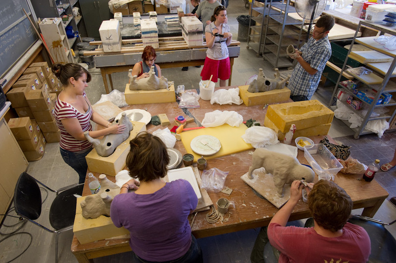 Buffalo State College Ceramics students assembling buffalo sculptures for fund-raiser.