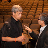 Author and social justice advocate Carl Wilkens speaking with audience member.
