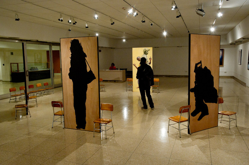 A student walks through artist Gary Wolfe's installation during the 2011 Anne Frank Project.
