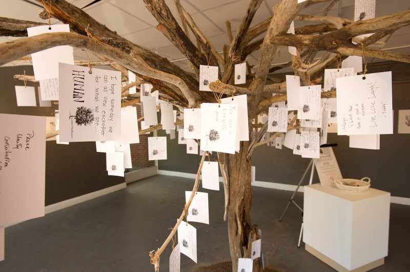 Hand-written messages hang from the Anne Frank Tree art installation during the 2011 Anne Frank Project at Buffalo State College.