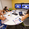 Students studying American Sign Language using the media:scape learning space in the Butler Library Study Quad.