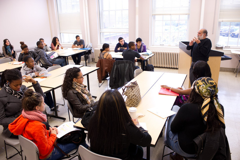 Author and social activist Victor Villanueva talking with Buffalo State students in class.