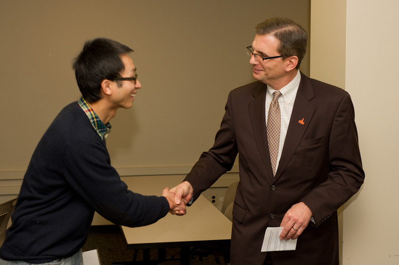 Presentation of International Graduate Student Scholarship by Dean Kevin Railey.