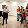 Artist Harold Cohen leading group through his art exhibit during the Anne Frank Project at Buffalo State.