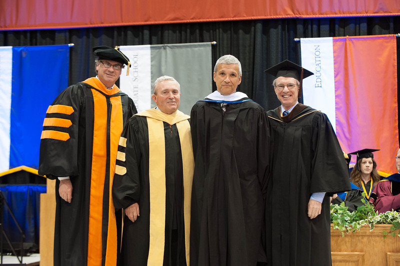 Social activist Carl Wilkens receiving honorary degree at the 10am Undergraduate Commencement at Buffalo State.