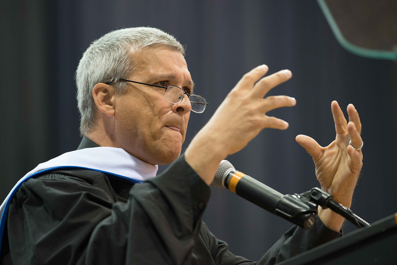 Social activist Carl Wilkens speaking at the 10am Undergraduate Commencement at Buffalo State.