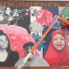 Installation of community mural on Lorigo's Meating Place near Buffalo State Community Academic Center.