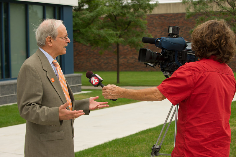 Interim President Howard Cohen being interviewed during Technology Building ribbon cutting at Buffalo State.