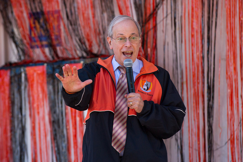 President Howard Cohen cheering on crowd during Buffalo State's 2013 Homecoming Pep Rally.