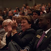 Audience listening to Interim President Howard Cohen addressing Buffalo State community in Rockwell Hall.