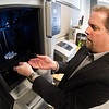 SUNY Buffalo State professor James Mayrose in Technology Department 3D printing area.