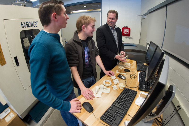 SUNY Buffalo State professor James Mayrose working with students in Technology Department 3D printing area.