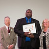 Bus driver Darnell Barton receiving award for helping prevent a suicide.