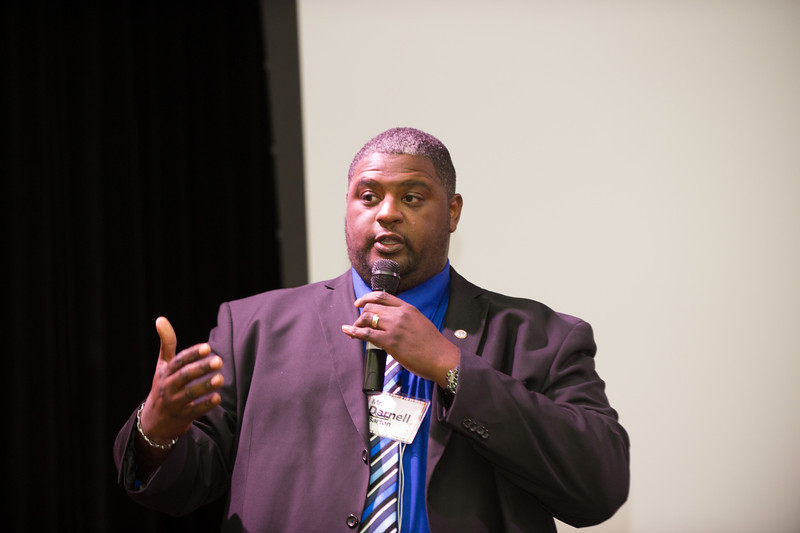 Bus driver Darnell Barton speaking during Mental Health Awareness Week at SUNY Buffalo State.