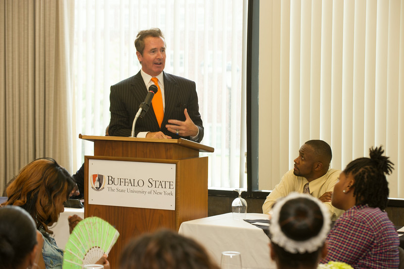 Congressman Brian Higgins speaking to highschool students and their parents during the Buffalo State Challenge awards luncheon.
