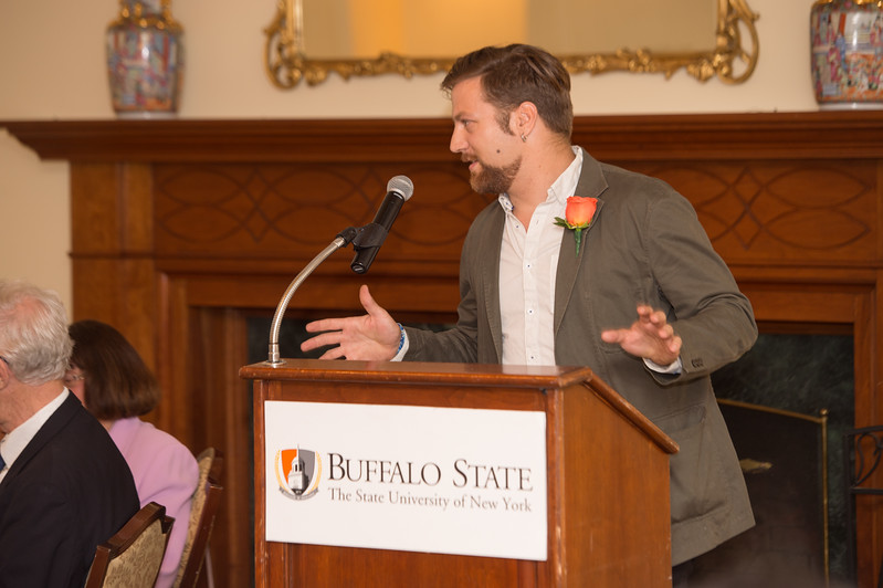 Wood Design student, Mathew Burch, speaking at the Peterson Society luncheon at Buffalo State College.