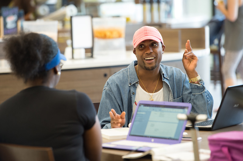 Students working in E.H. Butler Library at Buffalo State College.