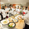 Students working in Hospitality and Tourism lab kitchen with Chef Donald Schmitter at Buffalo State College.