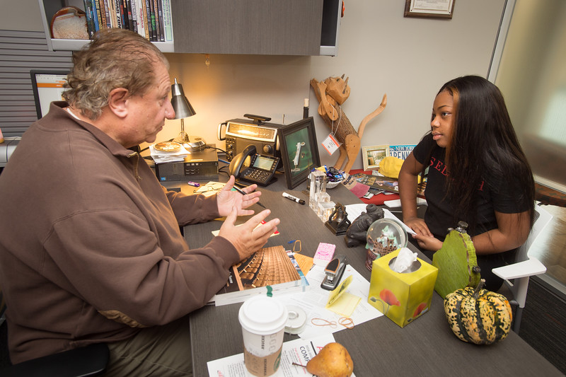 Communication professor Bruce Bryski advising student at Buffalo State College.