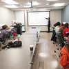 Professor Tammy McGovern working with students in her Communication class at Buffalo State College.