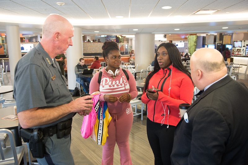 "Students, faculty and staff having ""Coffee WIth a Cop"" at Buffalo State College."