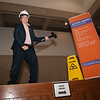 Provost Melanie Perreault takes a sledge hammer to the old circulation desk in the E.H. Butler Library at Buffalo State College.