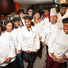 Group photo of Hospitality and Tourism Culinary Arts Club in lab kitchen at Buffalo State College.