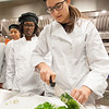 Hospitality and Tourism Culinary Arts Club working in lab kitchen at Buffalo State College.