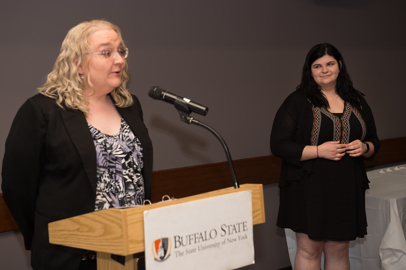 Student Kristine C. Murnicks  recieving the Dean's Medal during the School of Arts and Humanities Dean's Award Ceremony at Buffalo State College.