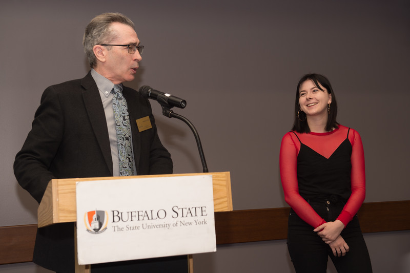 Student Rachel D. Repinz recieving the Dean's Medal during the School of Arts and Humanities Dean's Award Ceremony at Buffalo State College.