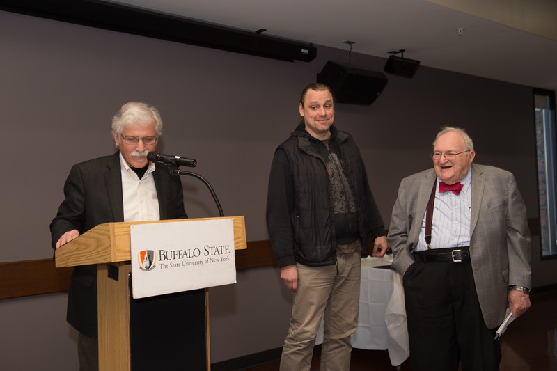 Student Nathanael W. Stolte receiving the Estelle M. Engel Memorial Scholarship during the School of Arts and Humanities Dean's Award Ceremony at Buffalo State College.