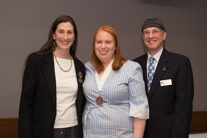 Student Shannon M. Stacy  recieving the Dean's Medal during the School of Arts and Humanities Dean's Award Ceremony at Buffalo State College.