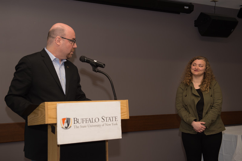 Student Robin C. Lazzara recieving the Dean's Medal during the School of Arts and Humanities Dean's Award Ceremony at Buffalo State College.