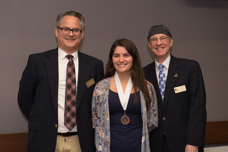 Student Lara Bax recieving the Dean's Medal during the School of Arts and Humanities Dean's Award Ceremony at Buffalo State College.