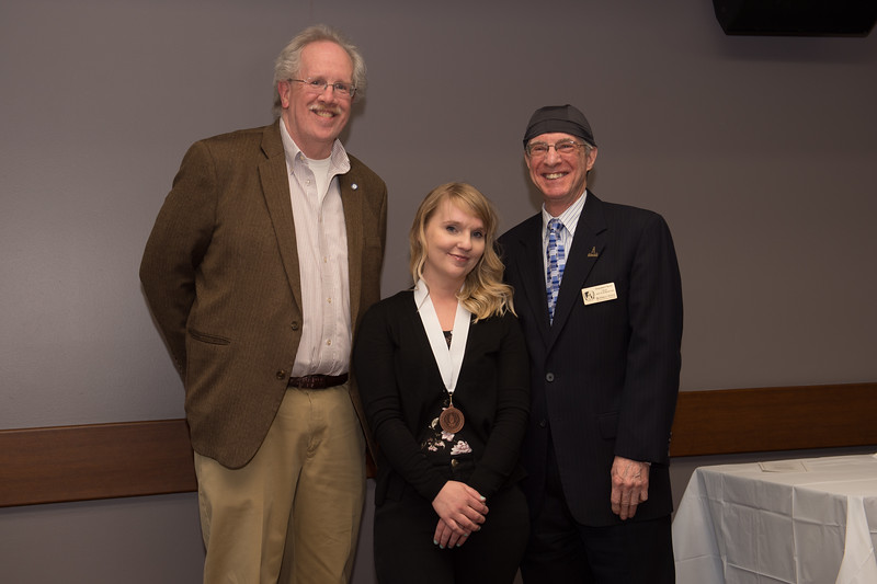 Student Lauren Walter  recieving the Dean's Medal during the School of Arts and Humanities Dean's Award Ceremony at Buffalo State College.