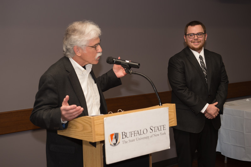 Student Andrew J. Butt  recieving the Dean's Medal during the School of Arts and Humanities Dean's Award Ceremony at Buffalo State College.