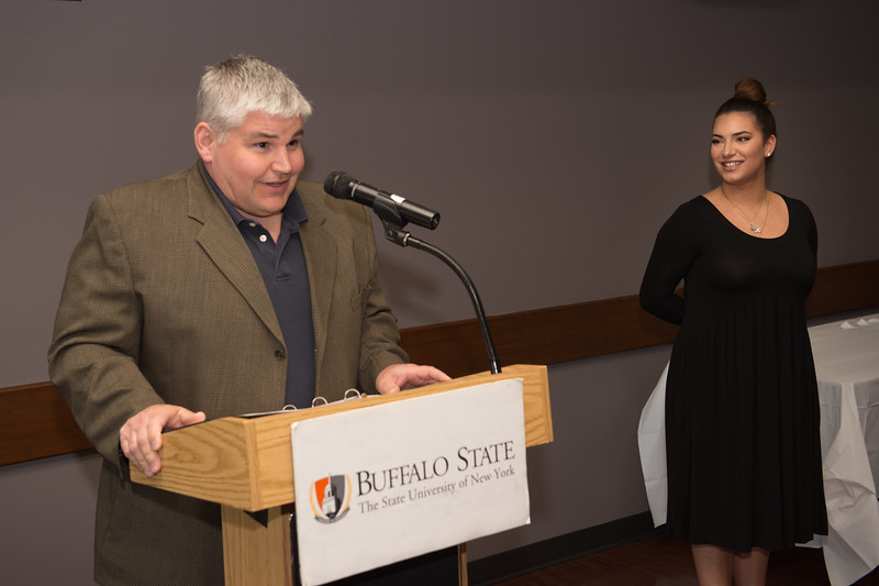 Student Emily Elise Cloutier  recieving the Dean's Medal during the School of Arts and Humanities Dean's Award Ceremony at Buffalo State College.